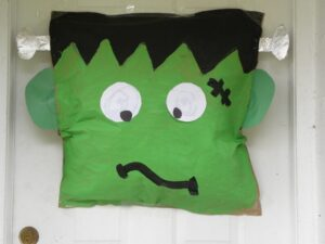 Kid friendly and so much fun for Halloween. Try this easy to make Frankenstein Door Decor for your families Halloween Decor this year!