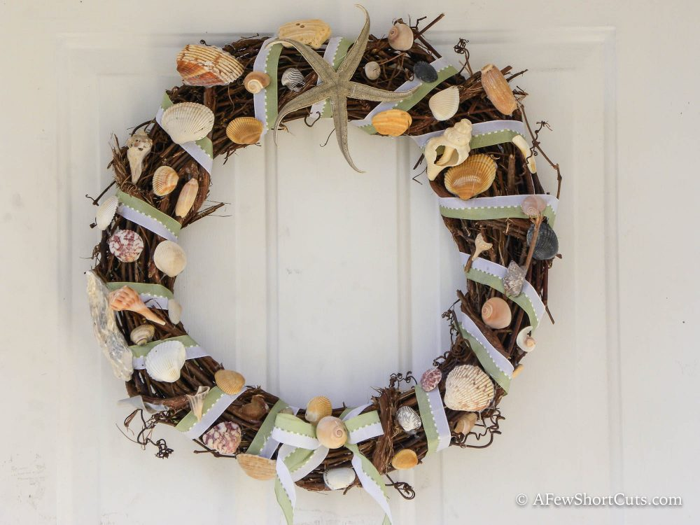 Not sure what to do with all of the seashells you collected at the beach? Check out this fun Summer Craft and make an easy Beach Wreath!