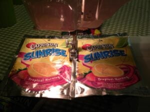 Recycle those old juice pouches and turn them into something useful! Learn how to make Capri Sun Bag quickly and easily! Great Earth Day Project!