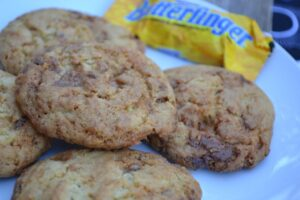 Nobody better lay a finger on my Butterfinger Cookies. This recipe uses a classic candy to really make a fantastic cookie!
