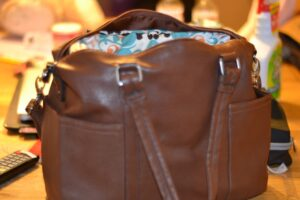 Get creative and turn a basic handbag into something amazing! Learn How to make your own custom camera bag.