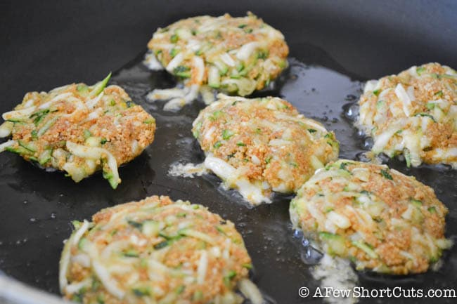 A fun and delicious way to try zucchini! This Cheesy Zucchini Cakes Recipe is a keeper! Makes a great appetizer or entree!