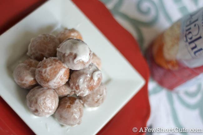 Being gluten free shouldn't mean missing out on your favorites! Check out this easy Glazed Gluten Free Doughnut Holes Recipe!