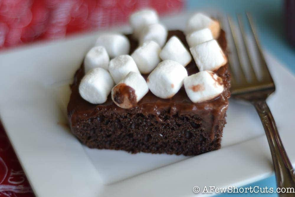 One of your favorite holiday flavors turned into a delicious chocolatey cake! Try this simple Hot Cocoa Poke Cake Recipe this winter!