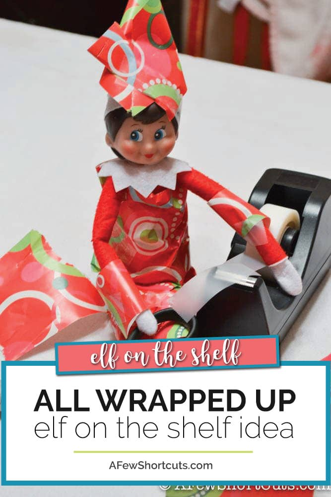 Grab some wrapping paper, tape and your elf for this simple All Wrapped Up Elf on the shelf Idea that is super cute and takes only minutes. | @AFewShortcuts #elfontheshelf #christmas #elfideas