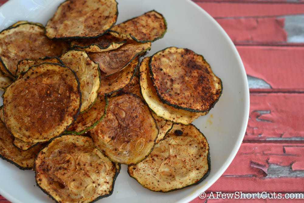Looking for a healthy snack recipe with a little bit of zing? Check out this simple Baked BBQ Zucchini Chips Recipe!