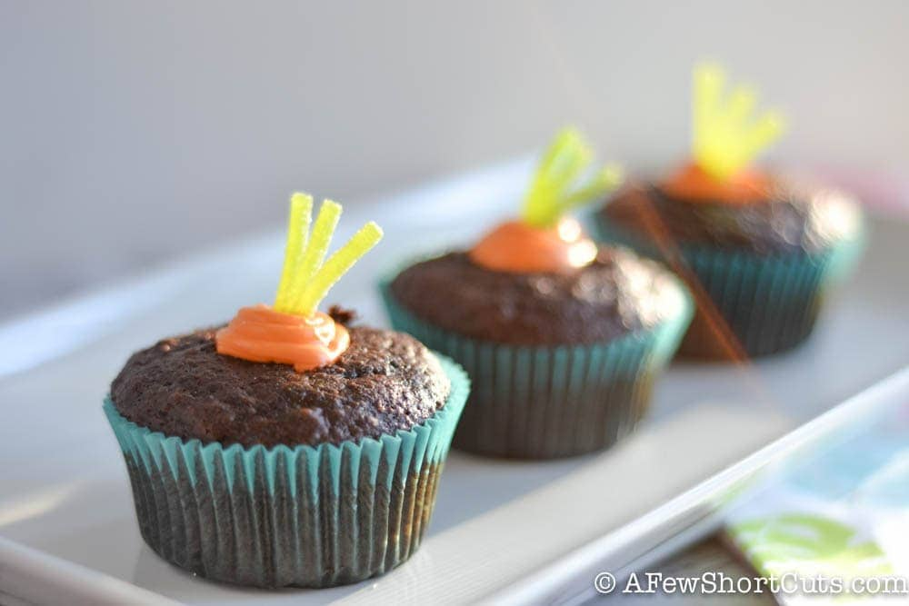 Check out these adorable Simple Spring Garden Cupcakes for Easter, Spring, or any Garden party. There is a little surprise when you take a bite into this easy recipe!