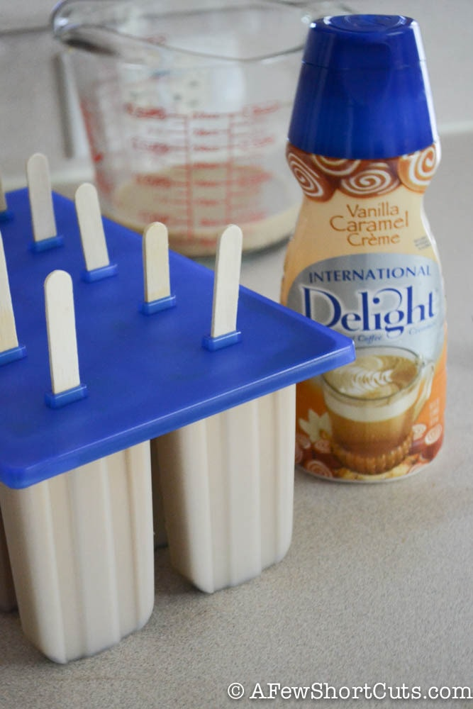 A grown-up sweet treat for when it is hot outside. Try this simple Caramel Mocha Iced Coffee Popsicles Recipe for a little afternoon pick me up.