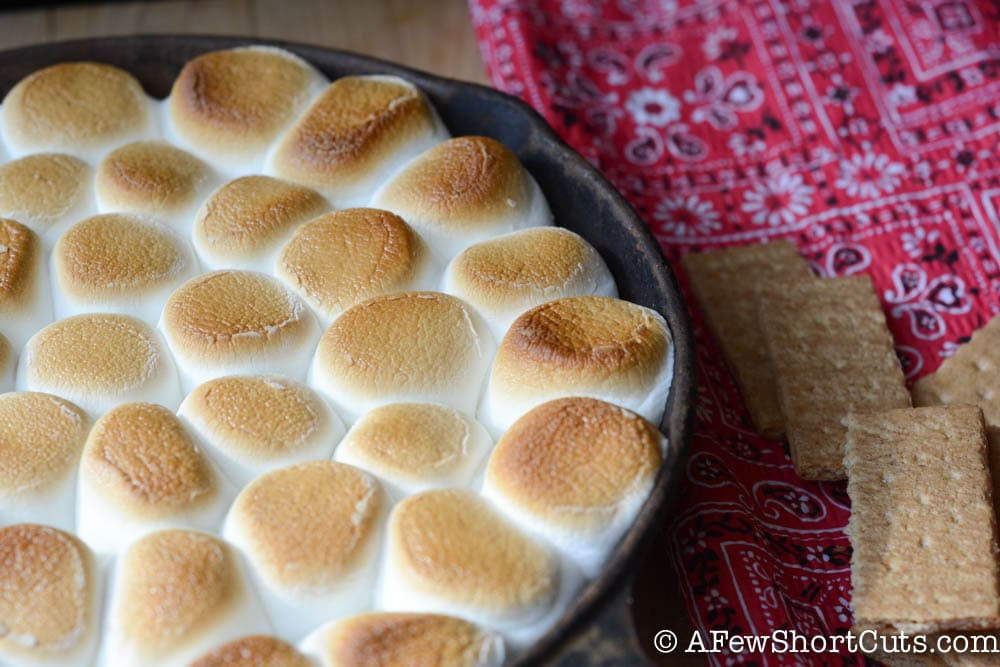 Chocolate. Marshmallow, and graham crackers! Too easy to be legal! Try this incredible S'Mores Dip #Recipe today with your family.