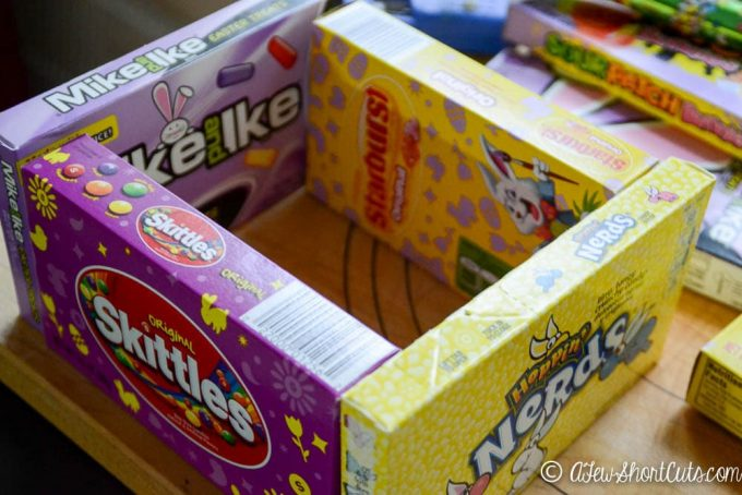 Simple Easter solution. The candy is the basket with theseeasy to make DIY Candy Box Easter Baskets! Snag some theatre boxes of candy and get crafty!