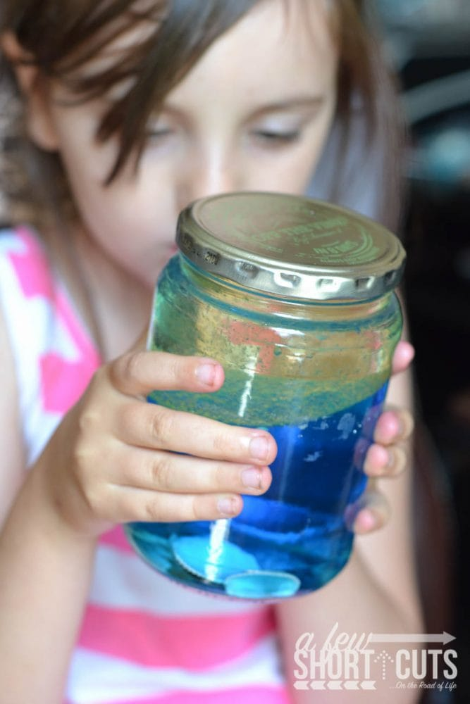 child holding jar