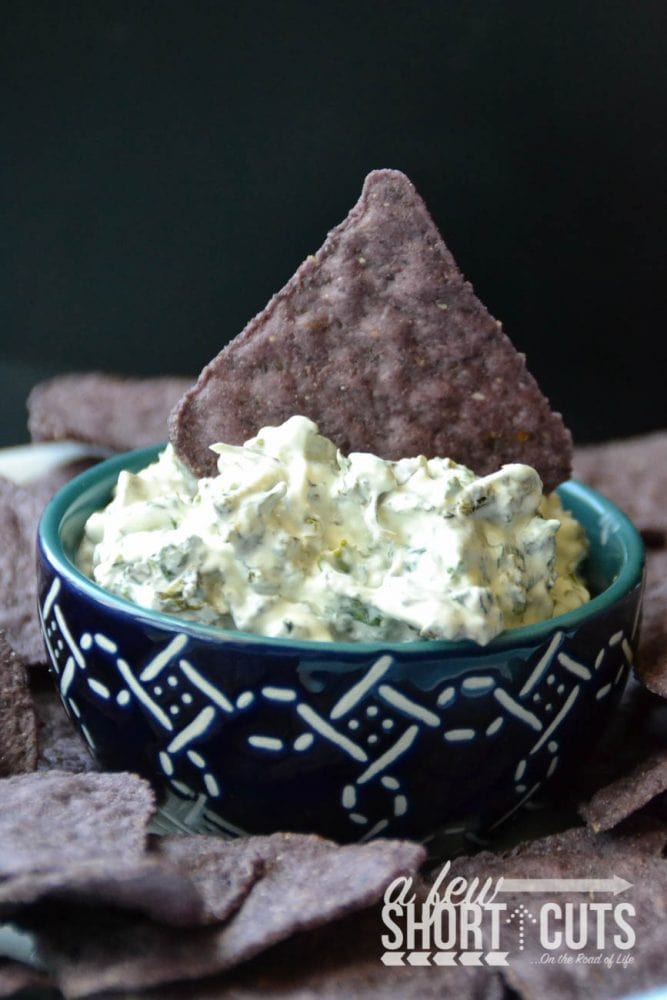 This is perfect for Shark Week! You have to make this Seaweed Dip with Shark Fin Chips Recipe! Also know as Spinach Dip with Blue Corn chips! YUM!