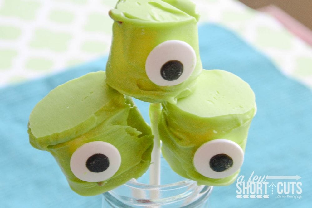 A fun Halloween Treat or perfect for a Monster's Inc. movie night! This simple Monster Marshmallow Pops Recipe will make the kids scream!