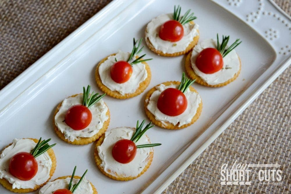 This is the perfect easy holiday appetizer recipe! Check out these Simple Tomato Rosemary Canapés!