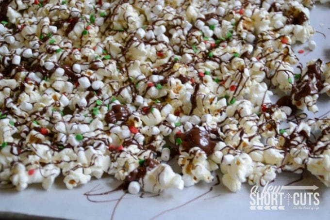 A great homemade holiday gift or just a christmas time treat! Check out this simple Hot Cocoa Popcorn Recipe! Can be made dairy free and it's naturally gluten free!