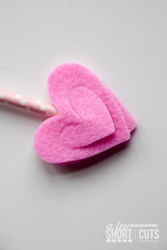 This simple craft is perfect for the kids to make this Valentine's Day! Put together this Cupid's Arrow Craft and take aim at someone you love with this fun DIY project.