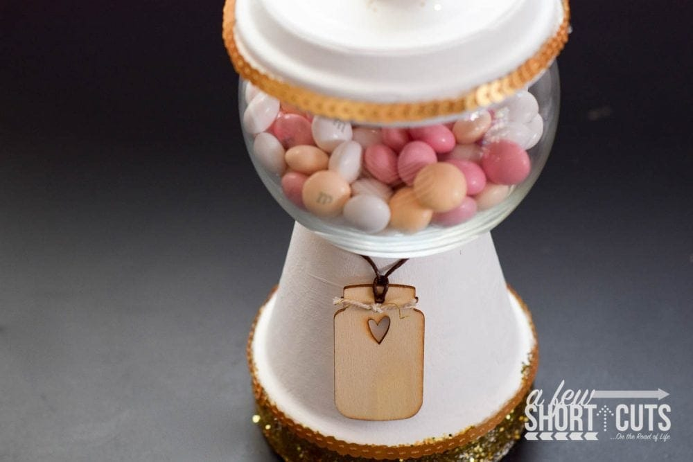 A fun simple craft that turns into a yummy decor item! Learn how to make a gumball machine candy dish!