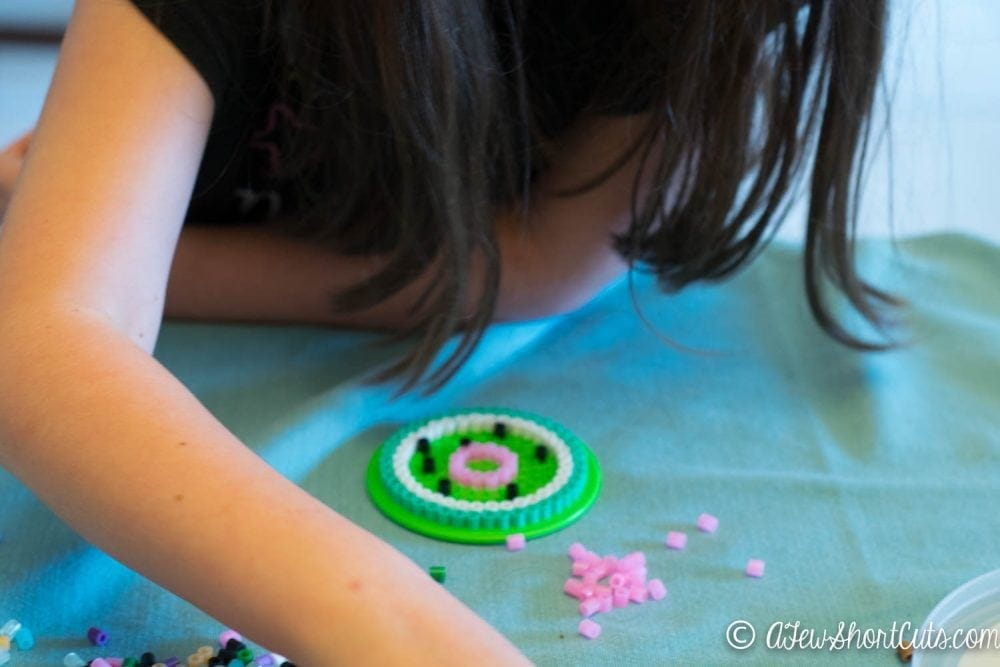 """Turn a case of the """"I'm boreds"""" into something useful and fun. Make this fun craft project for the kids Perler Bead Coasters & Drink Lids. A simple functional craft that they will love!"""