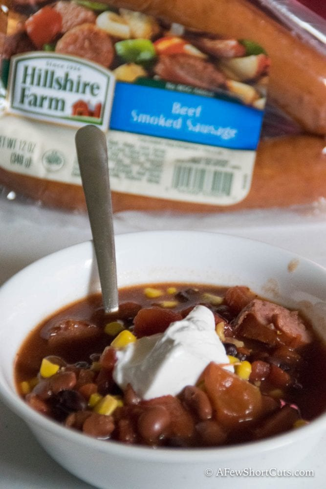 Need a quick and easy dinner? This Crockpot 7 Can & Sausage Soup is simple to throw together and feeds a crowd!