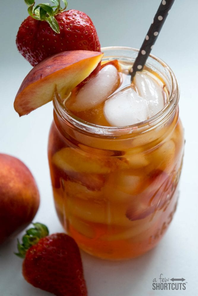 Don't put your Keurig away over the Summer! Check out this Peach Berry Iced Tea Recipe