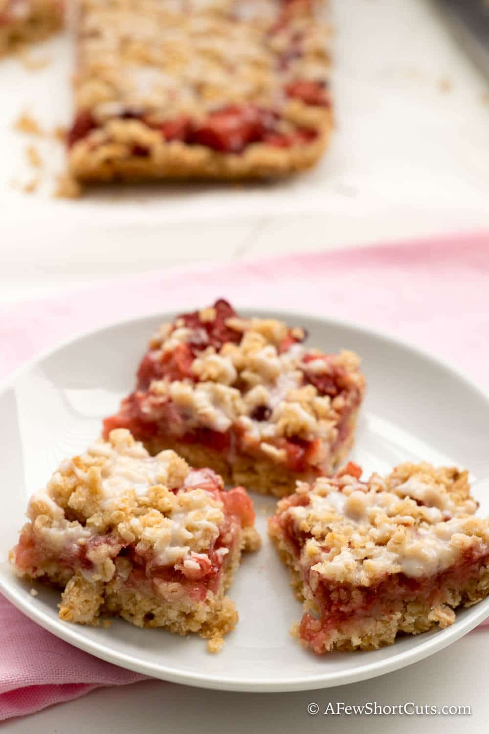 Strawberry Oatmeal Bars Recipe is a simple and tasty way to offer something special for breakfast or a snack. Comes with Gluten free and dairy free versions too!