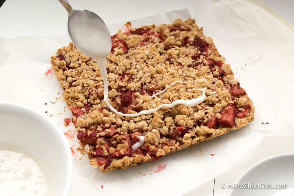 This Strawberry Oatmeal Bars Recipe is a keeper! Make the for breakfast, snack, or dessert. They are simply perfect! Can be made gluten free and dairy free too!