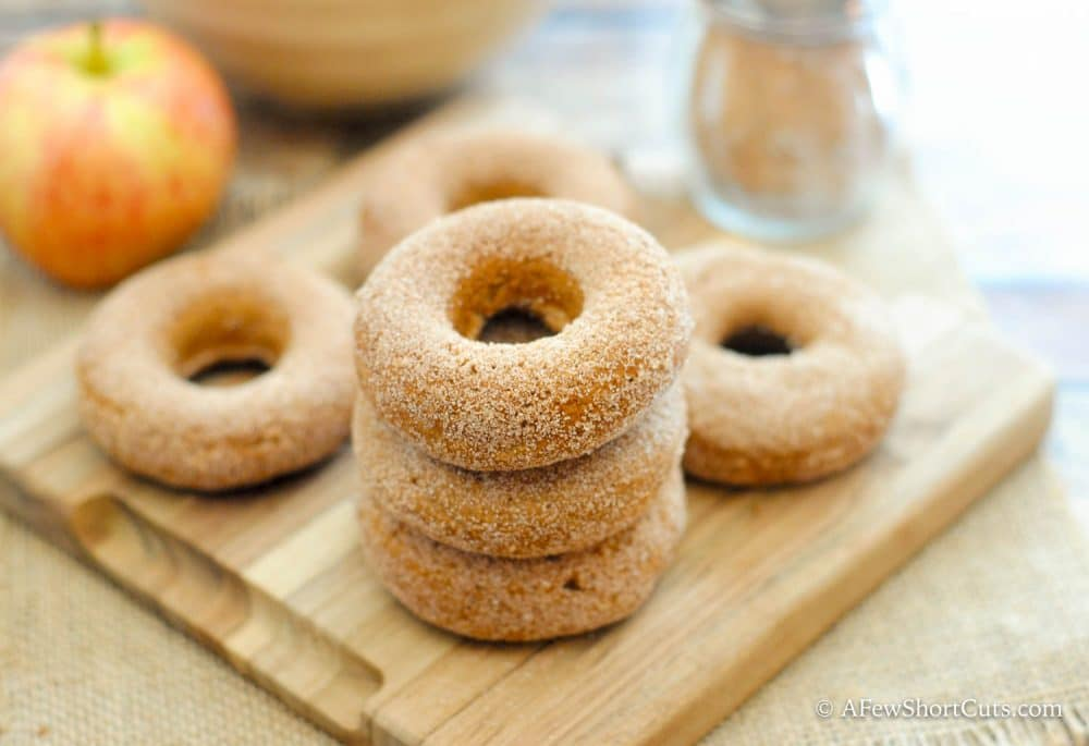 With fall breezing in, these Apple Spice Doughnuts are just what the scarecrow ordered! Make this simple recipe today!