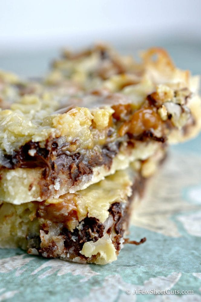 A unique twist on a classic girl scout cookie that every one loves! You must try this simple Samoa Bars Recipe! You can't eat just one!