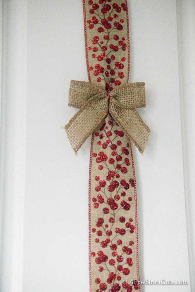 If you are looking for a quick and easy way to spruce up your kitchen this Christmas these Christmas Cabinet Ribbon Decorations are the way to go!  A simple holiday DIY!