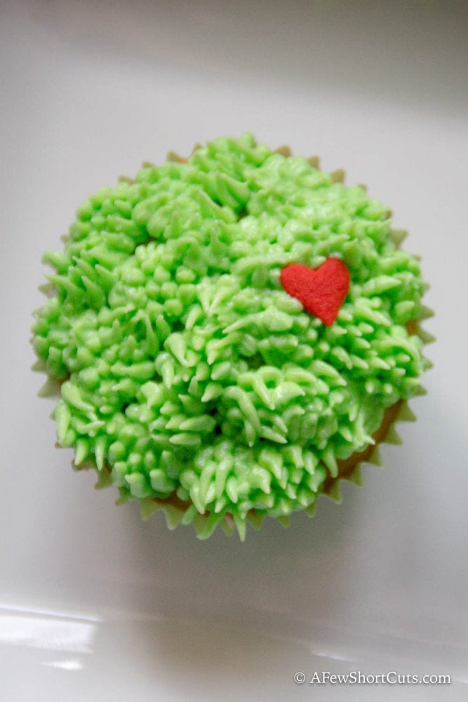 Grinch's small heart grew three sizes that day! These Grinch Cupcakes are super simple to make and too cute not to try! This recipe is a Christmas keeper!