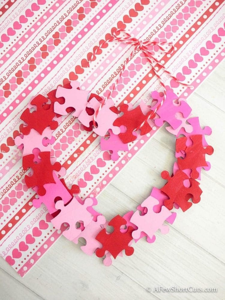 A simple and fun Valentine Wreath Kids Craft. This Piece of my Heart Wreath is an adorable way to upcycle an old puzzle!
