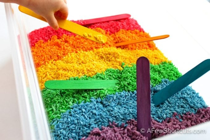 Little kids love getting their hands dirty. Give them something fun to dig into and learn How to Dye Rice for Sensory Play. A colorful way to play!