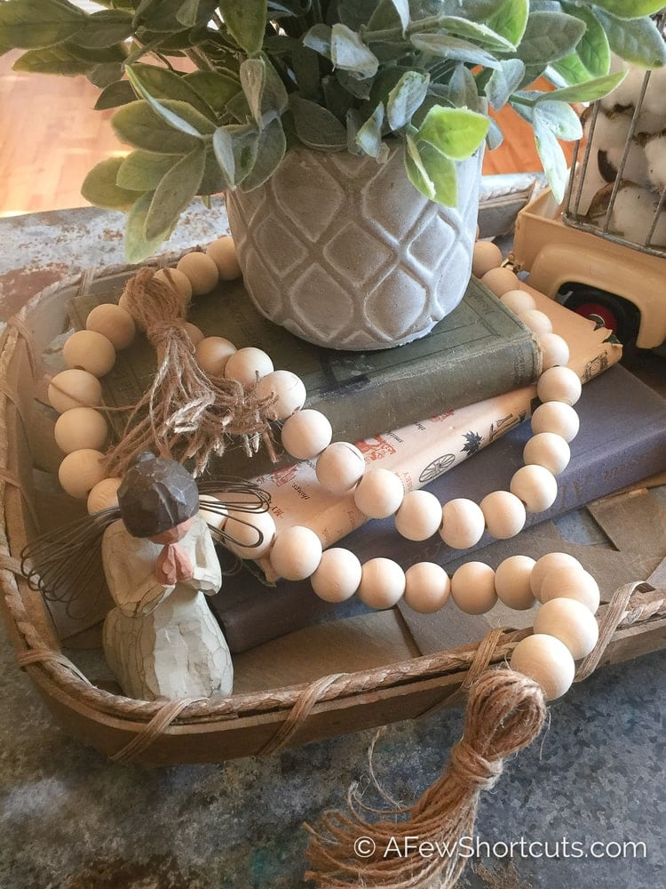 Wooden bead vase garland