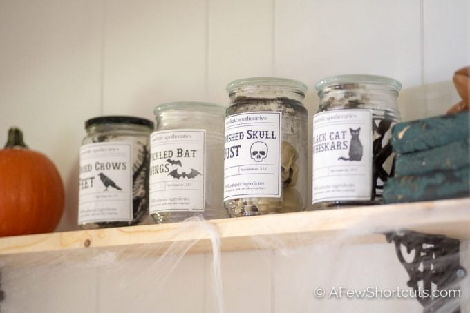 Add a spooky touch to your Halloween Decor with this simple Halloween project. Make these DIY Halloween Apothecary Jars and get the free printable labels too!   AFewShortcuts.com #printable #halloween #fall #spooky #diy #craft