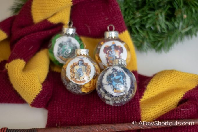 Hogwarts is home! Learn how to make your own DIY Harry Potter House Ornaments for Christmas with free printable! | @AFewShortcuts #harrypotter #christmas #craft #diy #hogwarts #printable