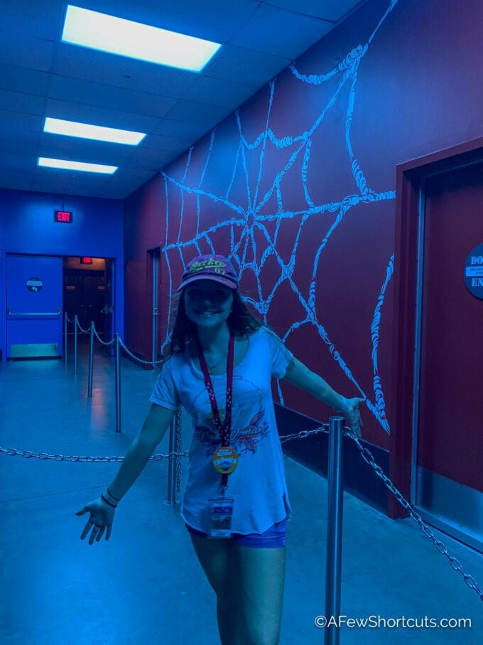 Girl in front of Spiderman web