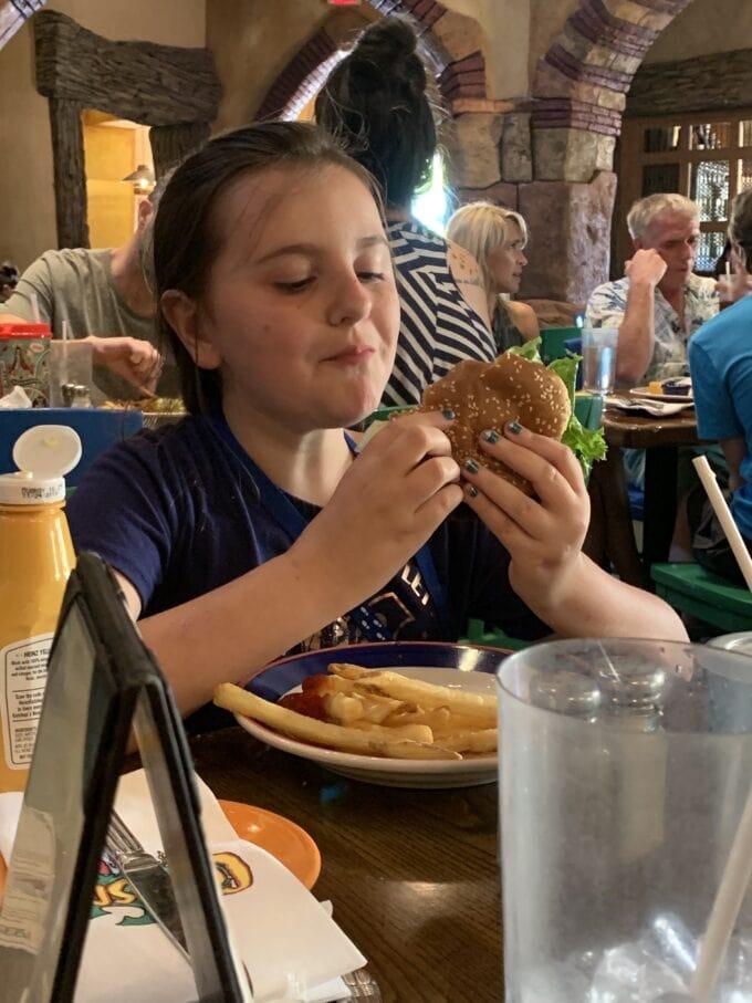 Girl with hamburger at confiscos