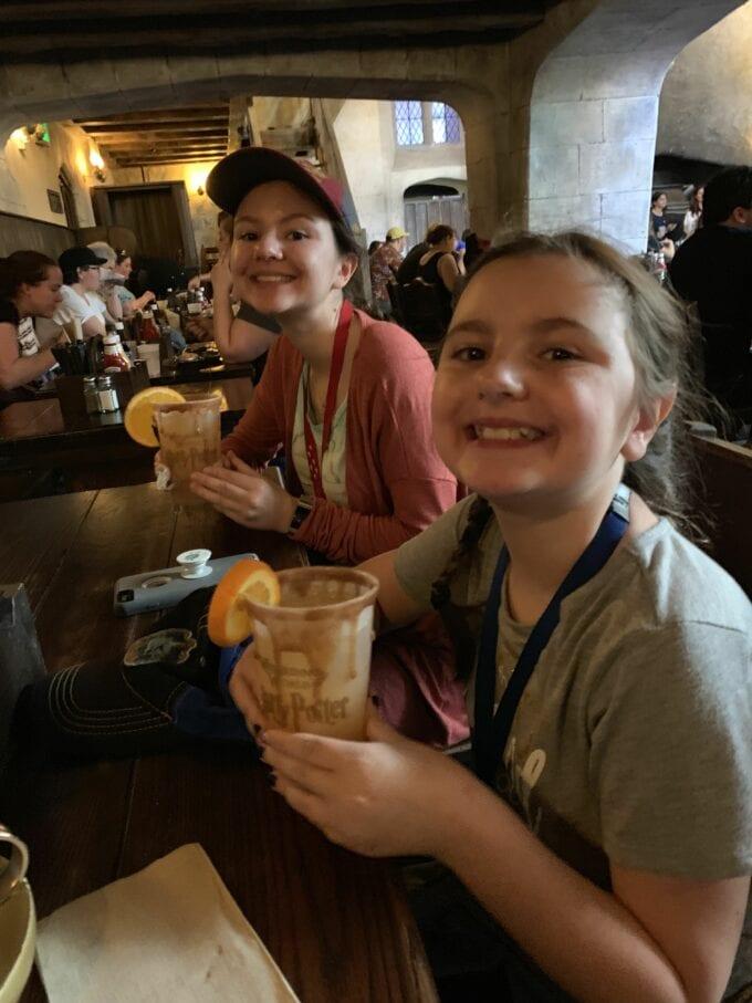 2 girls with orange fizz in leaky cauldron