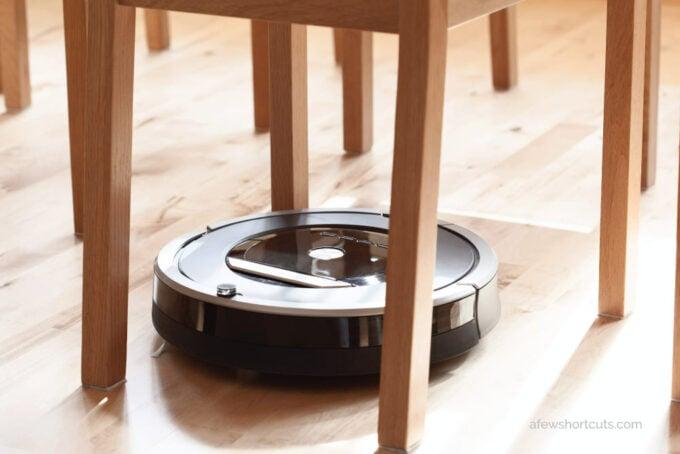 robot vacuum under chair