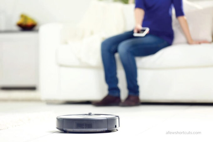 woman on couch with robot vacuum