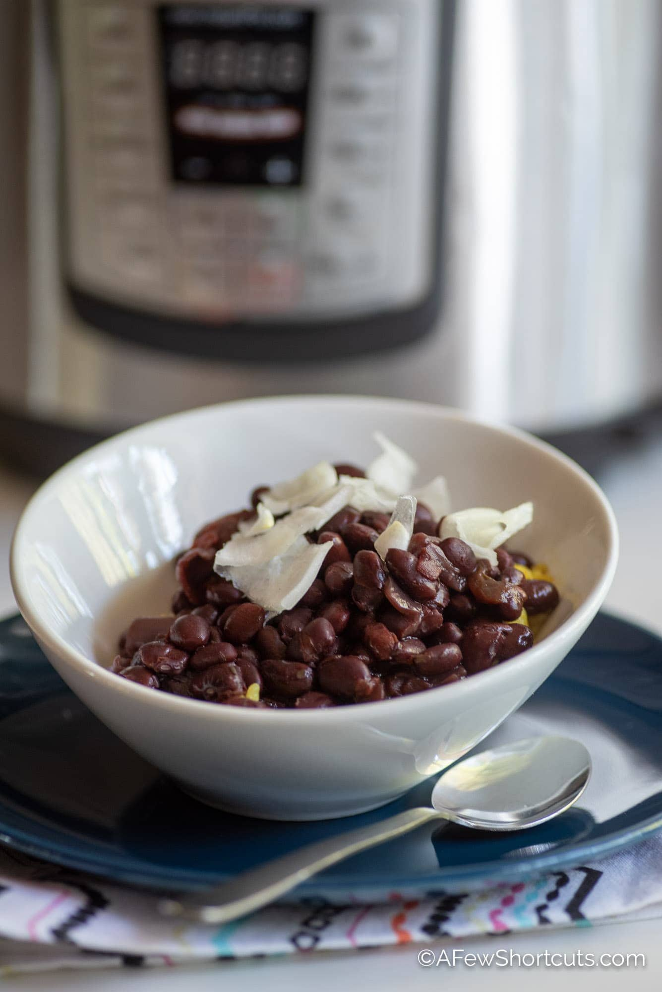 Bowl of black Beans in front of instant pot