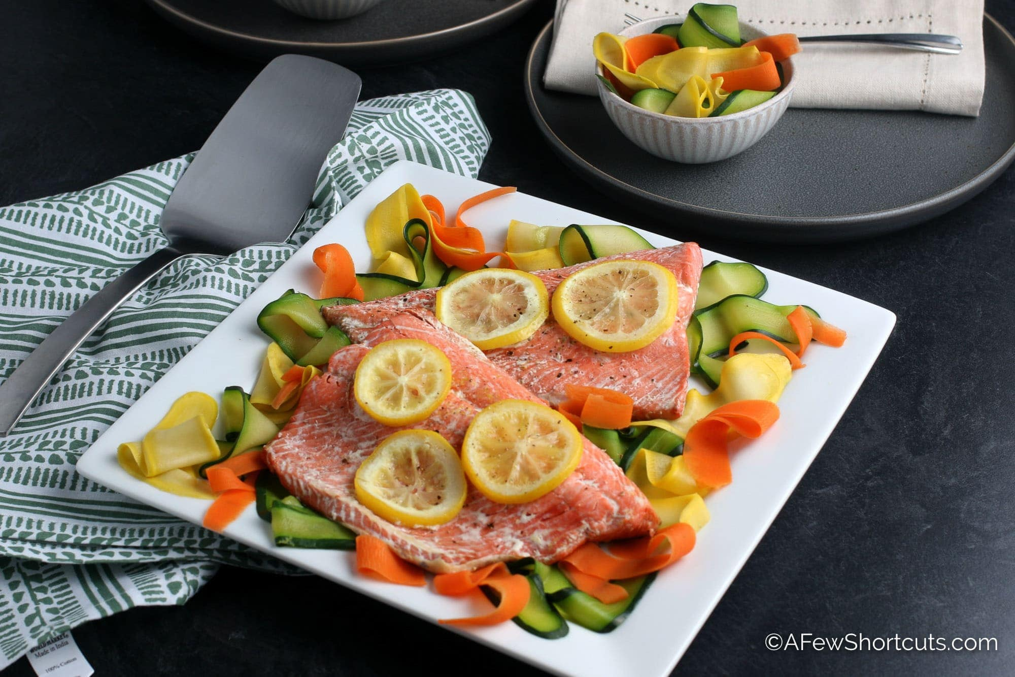 Instant Pot Salmon on square white plate with vegetables