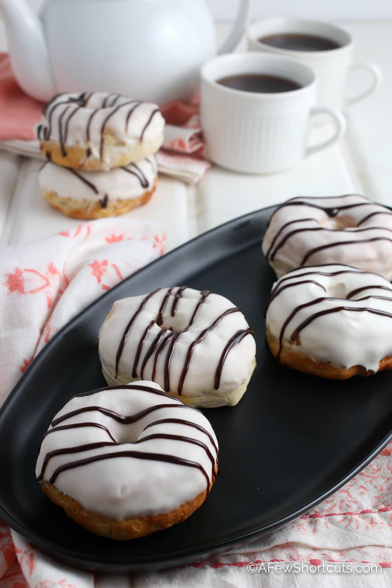 Air Fryer Donuts with Frosting and chocolate drizzle