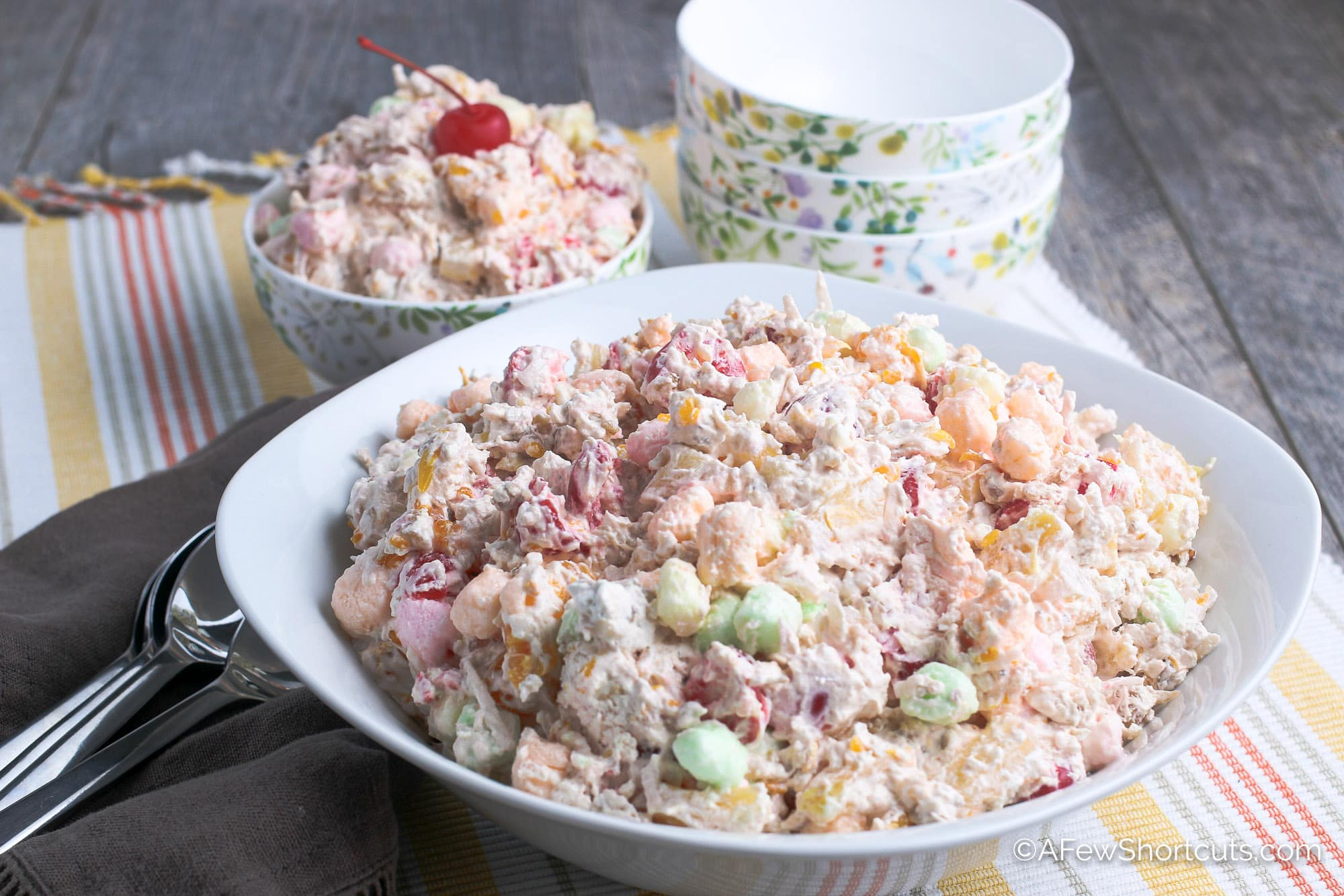 Ambrosia Salad in serving bowl with spoons