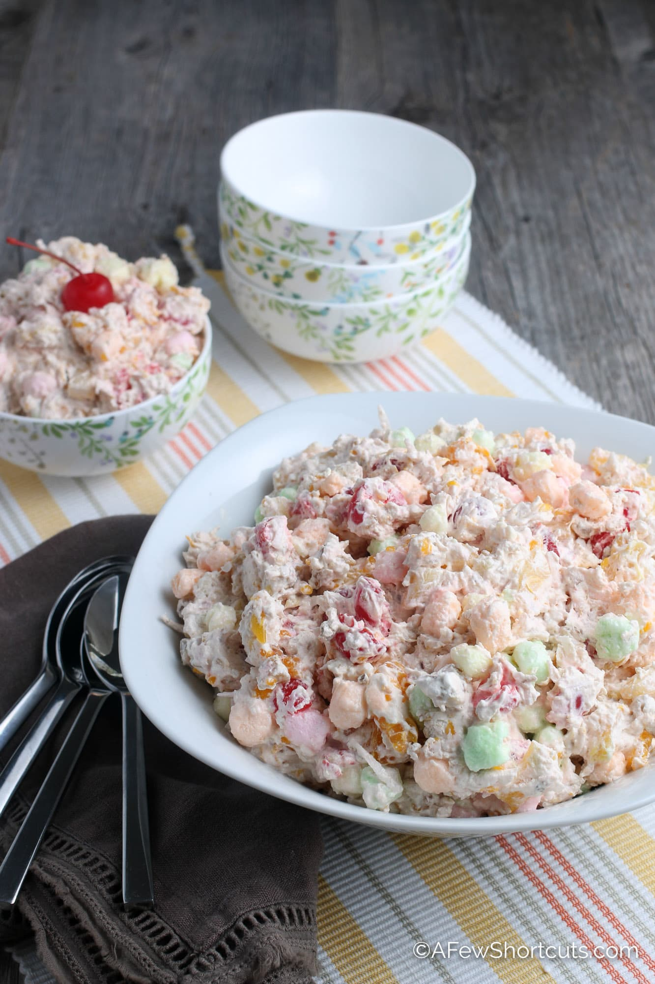 Ambrosia Salad in large bowl with small serving bowls