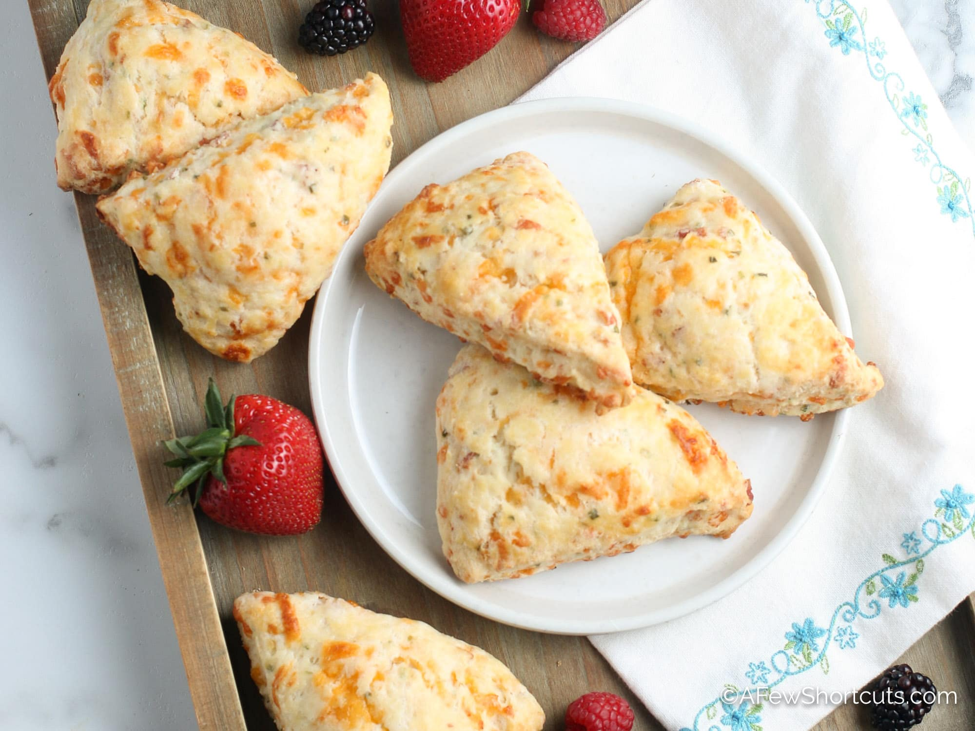 Bacon Cheddar Scones on plate with strawberries