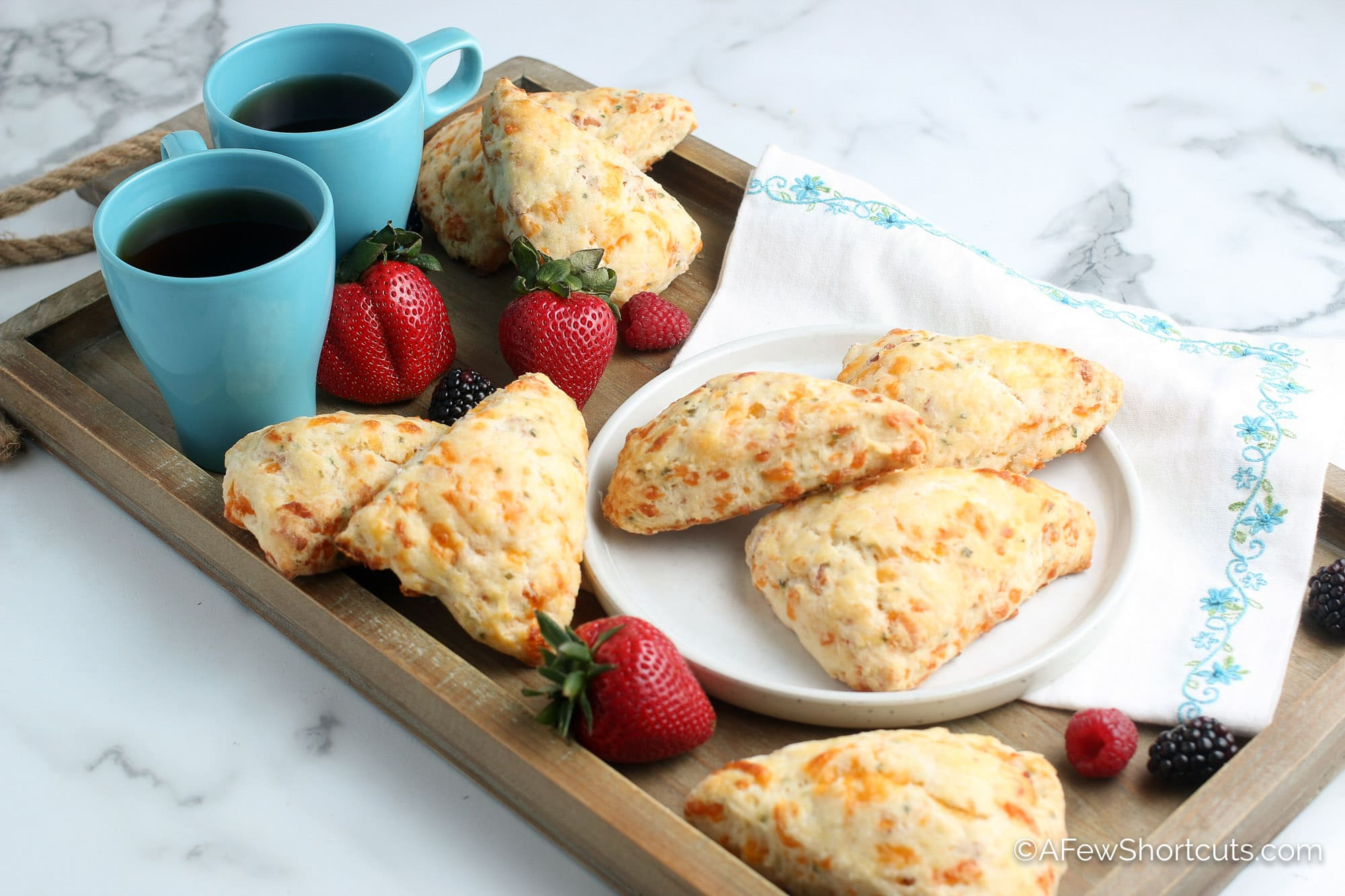 Bacon Cheddar Scones on tray with coffee and berries