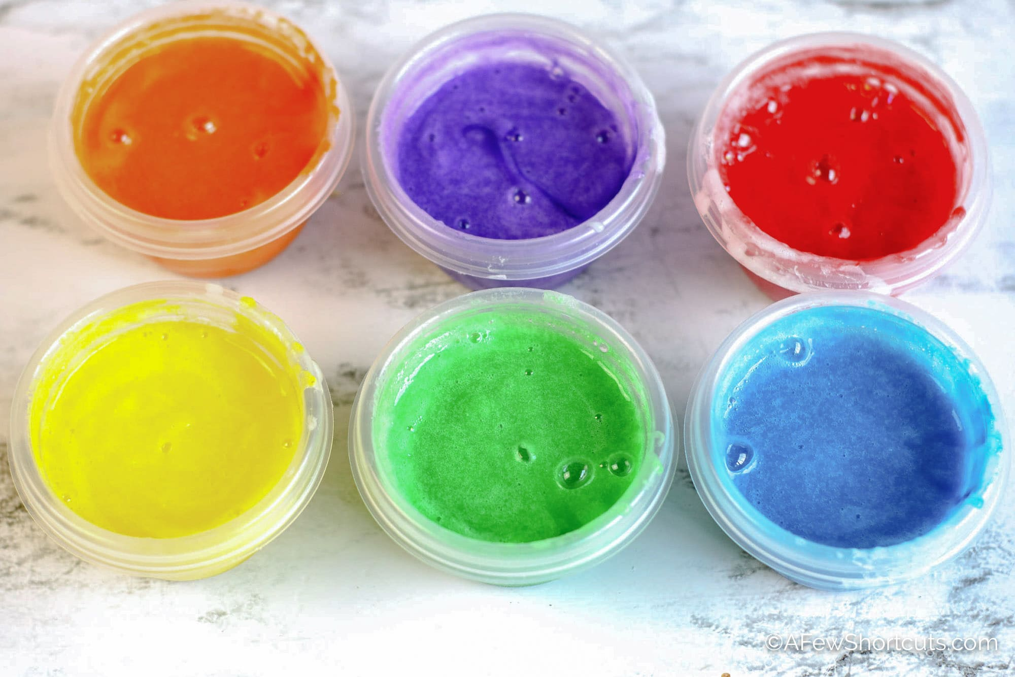 Homemade finger paint in cups.