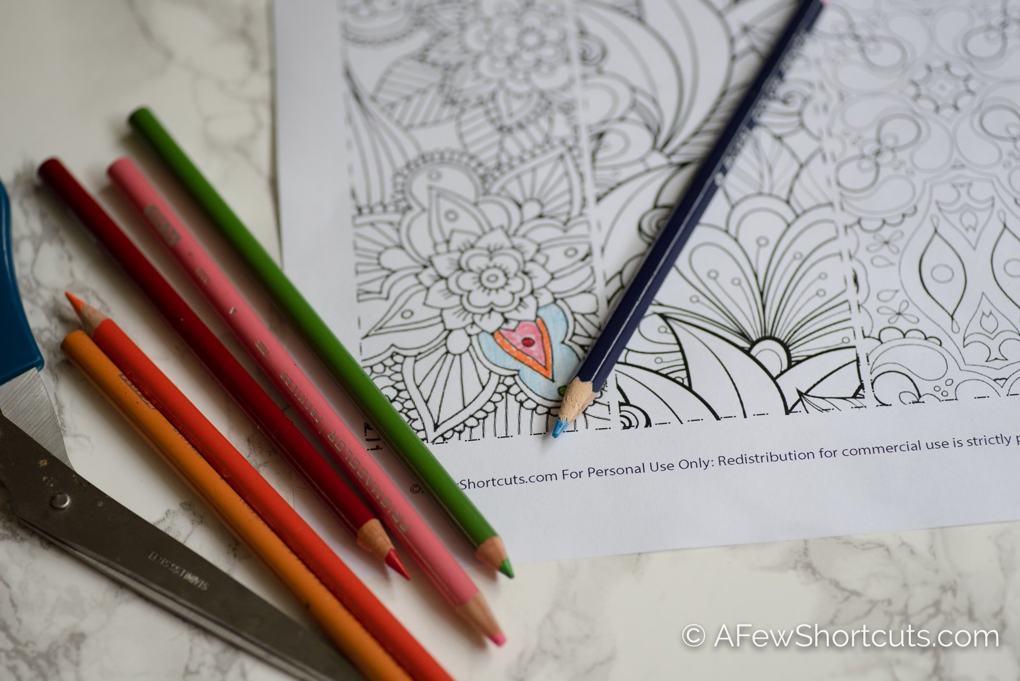 Colored pencils with coloring sheet