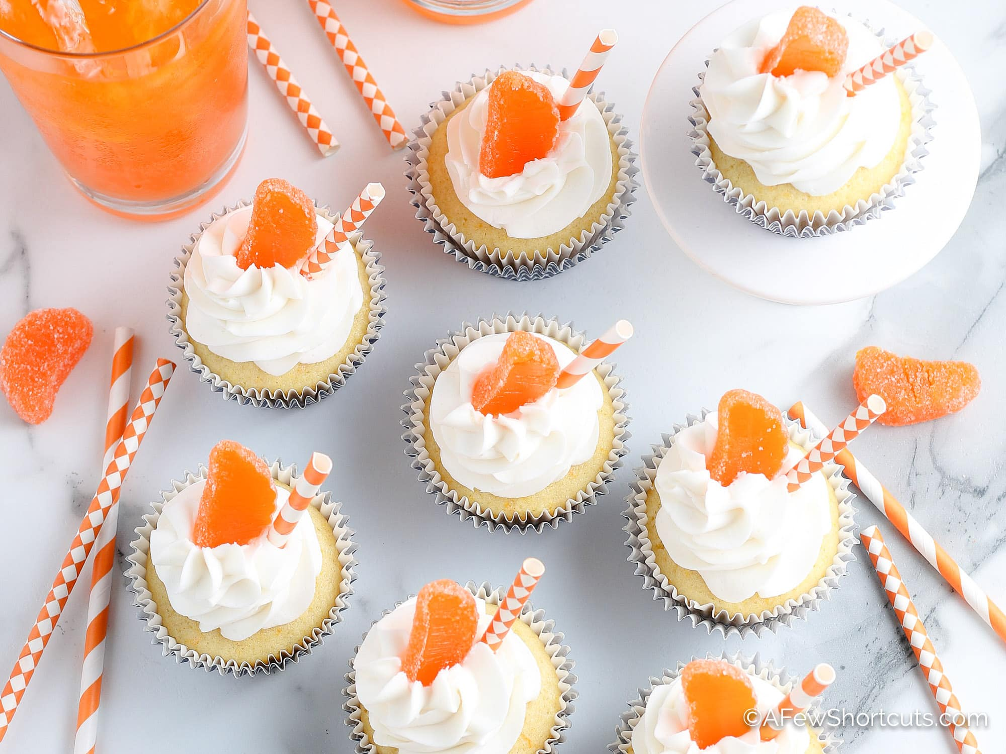 Orange Creamsicle Cupcakes Overhead picture with orange soda and straws
